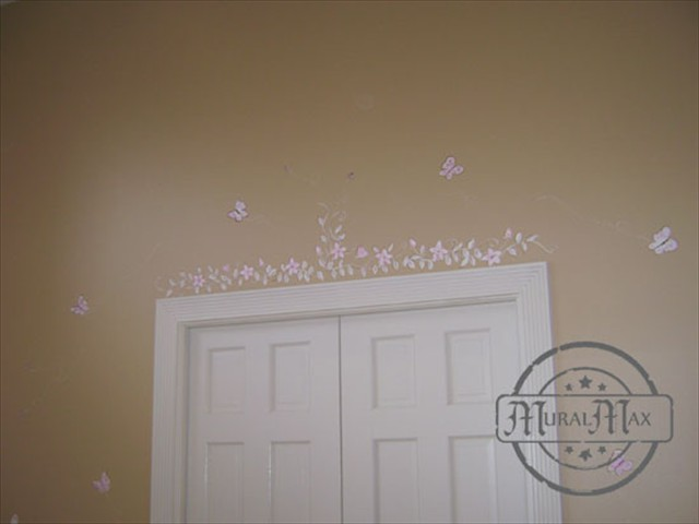 We painted delicate flowers and vine above the closet door